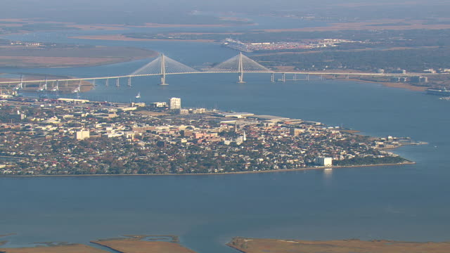 WS AERIAL View of bridge with Charleston city / South Carolina, United States