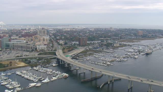 ws aerial view of bridge with marina at charleston city / south carolina, united states - south carolina stock videos & royalty-free footage