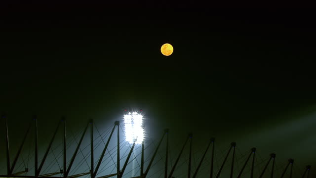 ws aerial zo view of bright moon above royal bafokeng stadium at hight / rustenburg, north west province, south africa - floodlight stock videos & royalty-free footage