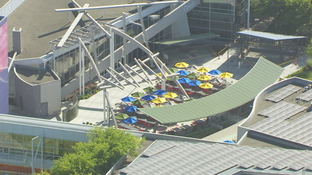 WS PAN AERIAL POV View of bright umbrellas at Googleplex, Google campus area / Mountain View, California, United States