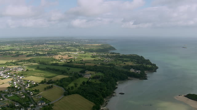 WS AERIAL View of Britanny coast west of Dinard with row houses and green landscape / Brittany, Channel Isles