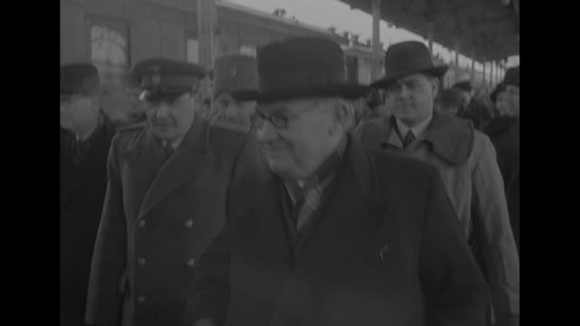 View of British Foreign Secretary Ernest Bevin in window of train car of train that has stopped in Belorussky station / Bevin greeted on train...