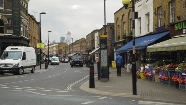 view of broadway market with city buildings in skyline - sir norman foster building stock videos & royalty-free footage