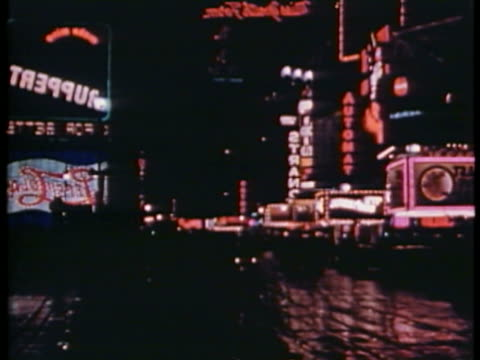 WS T/L View of Broadway with Times Square Neon and movie marquees / New York City, New York, USA.