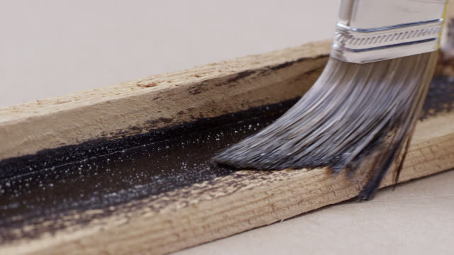 view of brush painting board with stain - wood stain stock videos & royalty-free footage