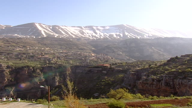 view of bsharri under snowcapped mount makmal - snowcapped mountain stock videos & royalty-free footage