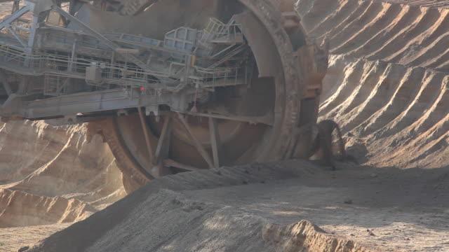 ws view of bucket wheel excavator moving in open pit coal mine / garzweiler, north rhine-westphalia, germany - bucket stock videos and b-roll footage