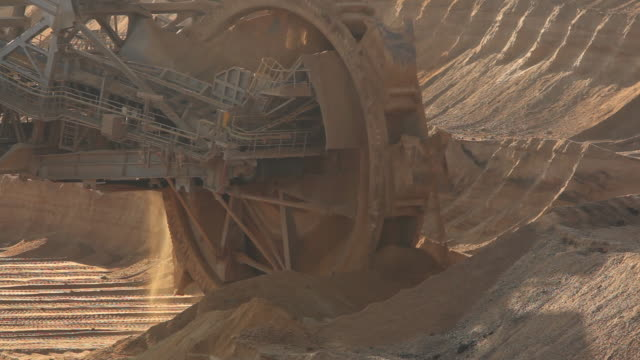 MS View of Bucket wheel excavator moving in open pit coal mine / Garzweiler, North Rhine-Westphalia, Germany