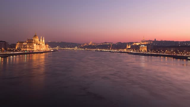view of buda and pest from the danube river at sunset, budapest, hungary - hungary stock videos & royalty-free footage