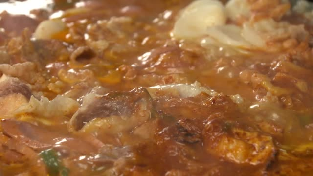 view of budae jjigae(korean style sausage stew) with chadolbaegi(korean style beef brisket) being boiled on the pot - brisket stock videos and b-roll footage