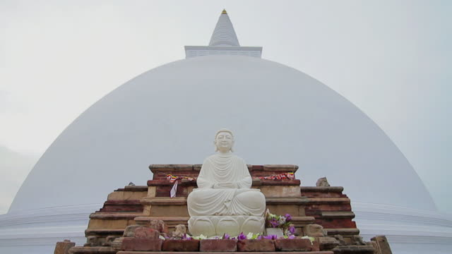 ms view of buddha statue in front of ruwanwelisaya dagoba or stupa / anuradhapura, north central province, sri lanka - stupa stock videos & royalty-free footage