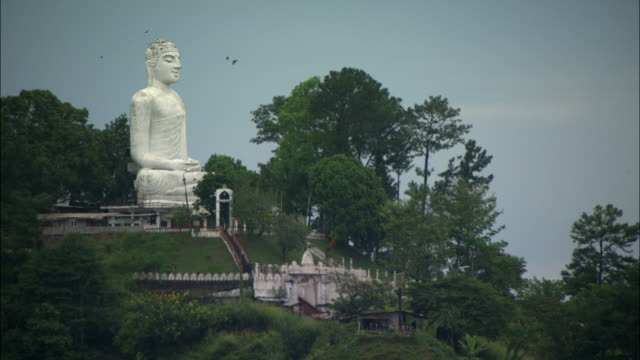ws view of buddha statue on hill / kandy, central province, sri lanka - sri lankan culture stock videos & royalty-free footage