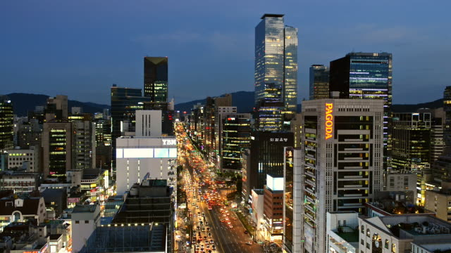 ws view of building and traffic at gangnam area at night / seoul, south korea  - lockdown video stock e b–roll