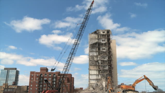 ws view of building demolition / chicago, illinois, usa - demolishing stock videos & royalty-free footage
