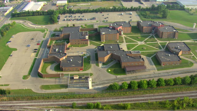 ws aerial zi view of  buildings and campus of mound correctional facility / detroit, michigan, united states - prison building stock videos & royalty-free footage