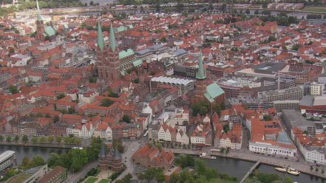 ws aerial view of buildings and churches in lubeck / germany - lübeck stock-videos und b-roll-filmmaterial