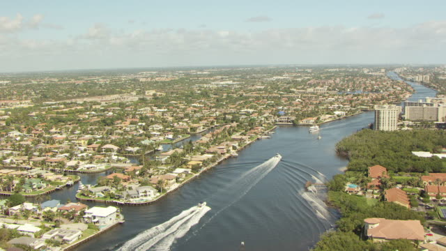 WS AERIAL View of buildings and condos and along beach in Palm Beach County / Florida, United States