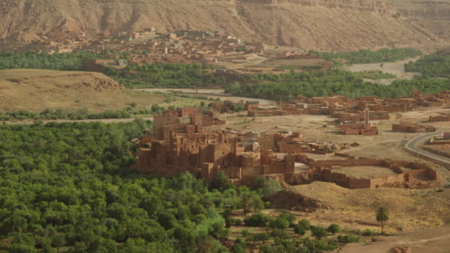 vidéos et rushes de view of buildings and forest area in north morocco, africa - maroc