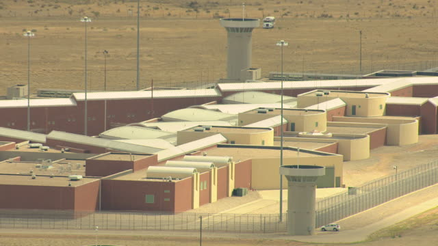 ms ds zi aerial view of buildings and lookout towers and barbed wired fence at florence supermax prison / colorado, united states - gefängnis stock-videos und b-roll-filmmaterial