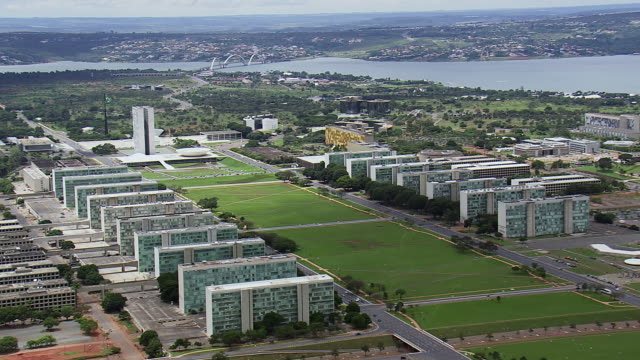 ws aerial view of buildings and river / brasilia, brazil - brasilia stock videos and b-roll footage