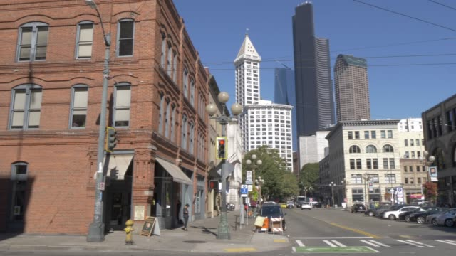view of buildings and street scene on kings street, pioneer square district, seattle, washington state, united states of america, north america - smith tower stock videos & royalty-free footage