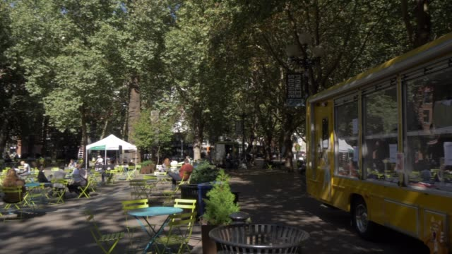 view of buildings and street scene on occidental square, pioneer square district, seattle, washington state, united states of america, north america - seattle stock videos & royalty-free footage