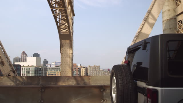 ws pov view of buildings and traffic moving on queensborough bridge / new york, united states - cantilever stock videos & royalty-free footage
