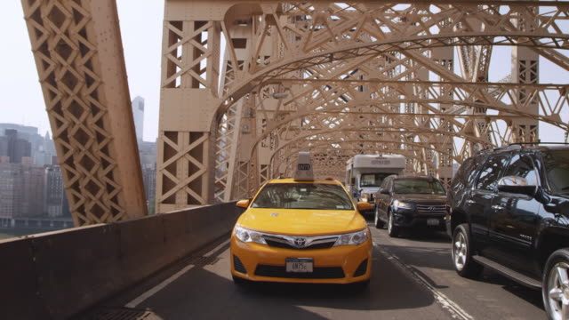 WS POV View of buildings and traffic moving on Queensborough Bridge / New York, United States