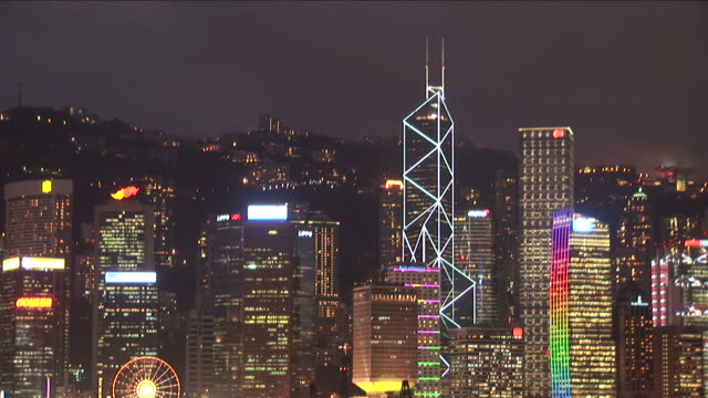 view of buildings at night in hong kong china - bank of china tower hong kong stock videos & royalty-free footage