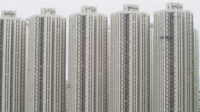 ws pan view of buildings / hong kong, hong kong - repetition stock videos & royalty-free footage