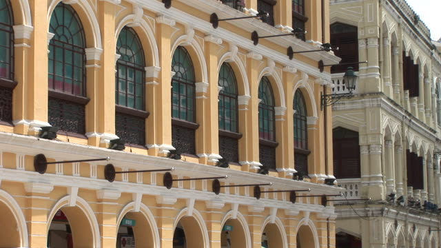 view of buildings in senado square of macau china - leal senado square stock videos and b-roll footage