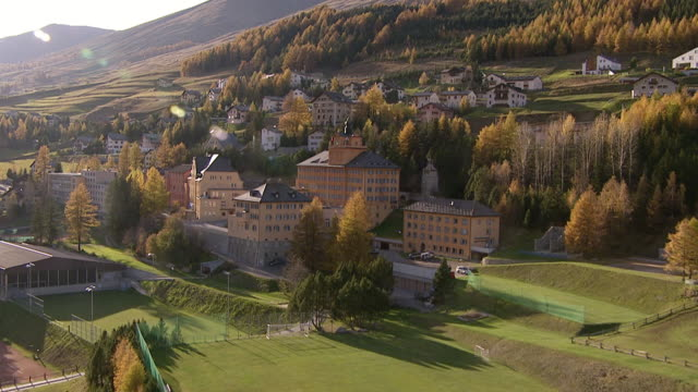 ws aerial view of buildings of residential school lyceum alpinum in village of zuoz / zuoz, upper engadin, switzerland - boarding school stock videos & royalty-free footage