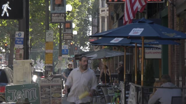 view of buildings, signs, shops in pioneer square district, seattle, washington state, united states of america, north america - seattle stock videos & royalty-free footage