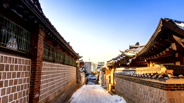view of bukchon hanok village alley (famous place for traditional korean house and popular tourist destinations) in winter - alley stock videos & royalty-free footage