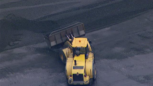 MS AERIAL View of bulldozer loading coal on coal train / Mandalong, New South Wales, Australia