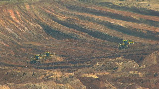 WS AERIAL View of bulldozers working in mine / Darwin, Northern Territory, Australia