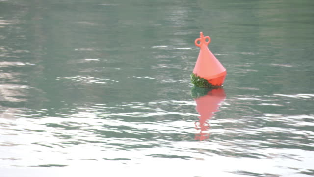 WS View of buoy in sea / Various, Spain