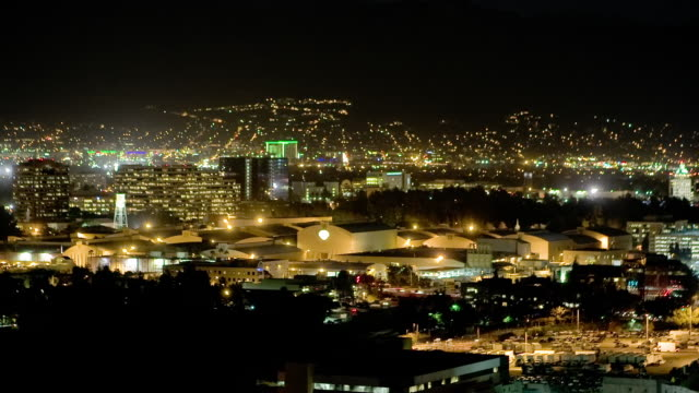 T/L, WS, HA, View of Burbank with Warner Bros studio sound stages at night, Universal City, California, USA