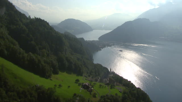 ws aerial view of burgenstock with lake alpnach and lakelucerne with village furigen and stansstad / burgenstock, lucerne, switzerland - lake stock videos & royalty-free footage