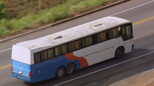 ws aerial view of bus moving on highway / brazil - bus stock videos & royalty-free footage