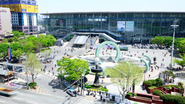 view of busan station with water fountain - busan stock videos & royalty-free footage