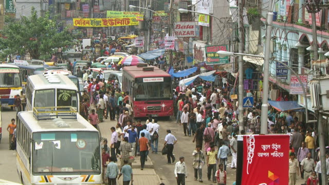 WS View of buses and pedestrians in congested at city center / Dhaka, Bangladesh