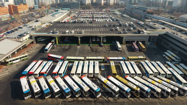 view of buses moving in and out of seoul express bus terminal - fleet of vehicles stock videos and b-roll footage