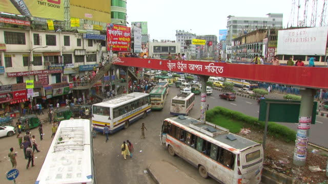 WS HA View of busy intersection at city center buses and traffic under pedestrian overpass / Dhaka, Bangladesh