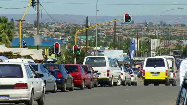 WS View of busy street in township / Tembisa, Gauteng, South Africa