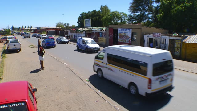 ws tu td view of busy street in township / tembisa, gauteng, south africa - taxi stock videos & royalty-free footage