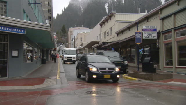 ws td zo view of busy streets of juneau with mountains in background / juneau, alaska, usa - juneau stock videos and b-roll footage