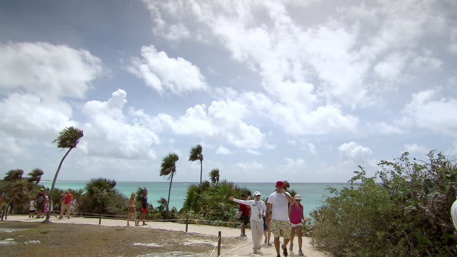 ws view of busy tourist path to pyramid el castillo [the castle] / tulum, quintana roo, mexico - quintana roo stock videos and b-roll footage