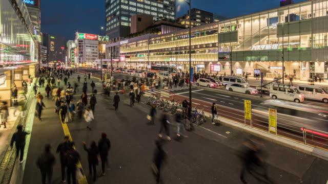 T/L WS View of Busy Traffic in Shinjuku at Night / Tokyo, Japan