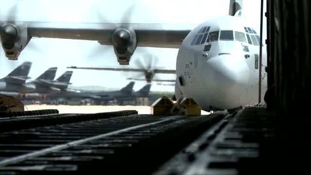 View of C130 Hercules from the back ramp of another C130 Hercules